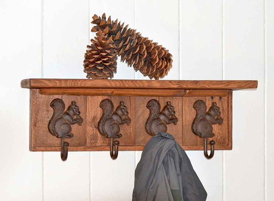 antique finish wall mount coat rack with shelf and four cast iron squirrel coat hooks