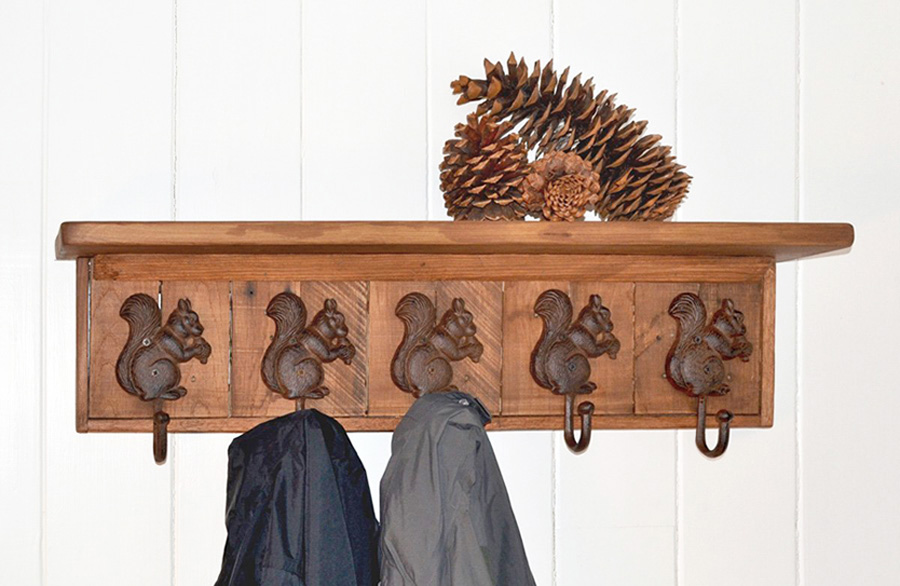wall mounted coat rack with 5 cast iron squirrel coat hooks